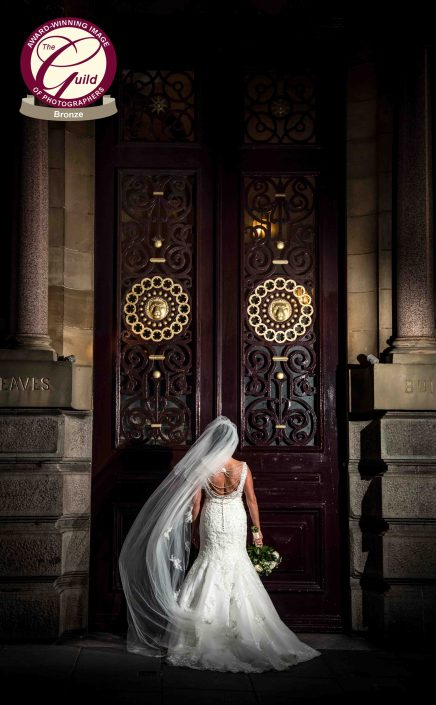 bride near big doors