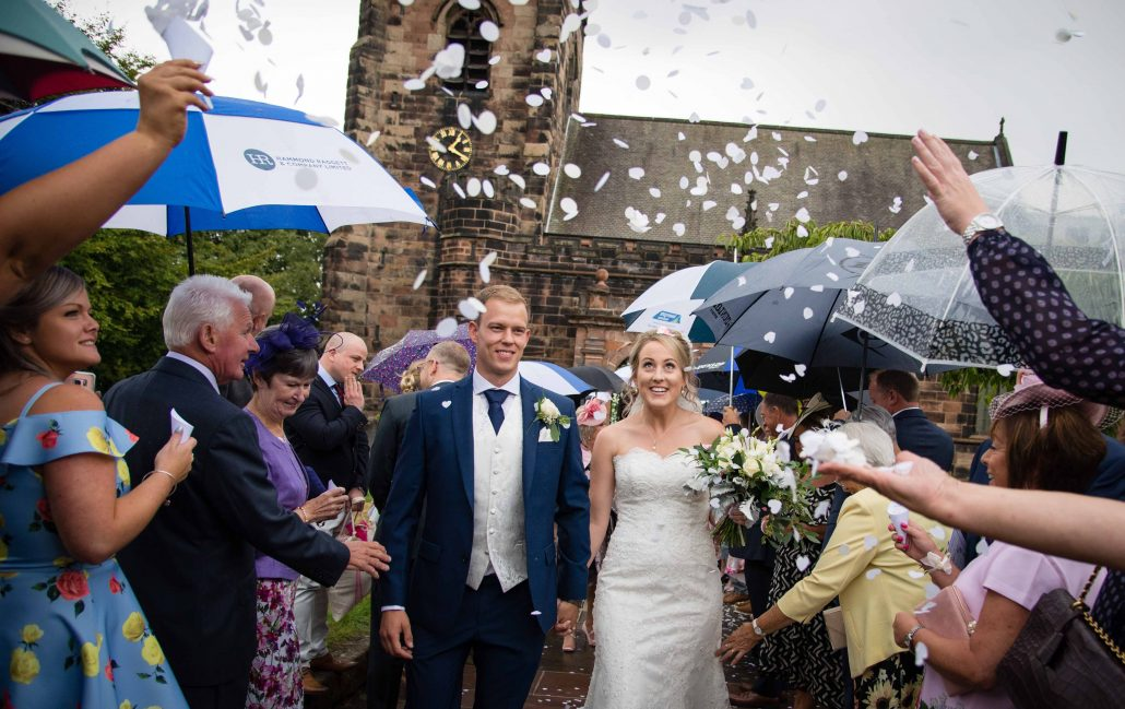 North West wedding at Delamere Manor. Couple walking through confetti