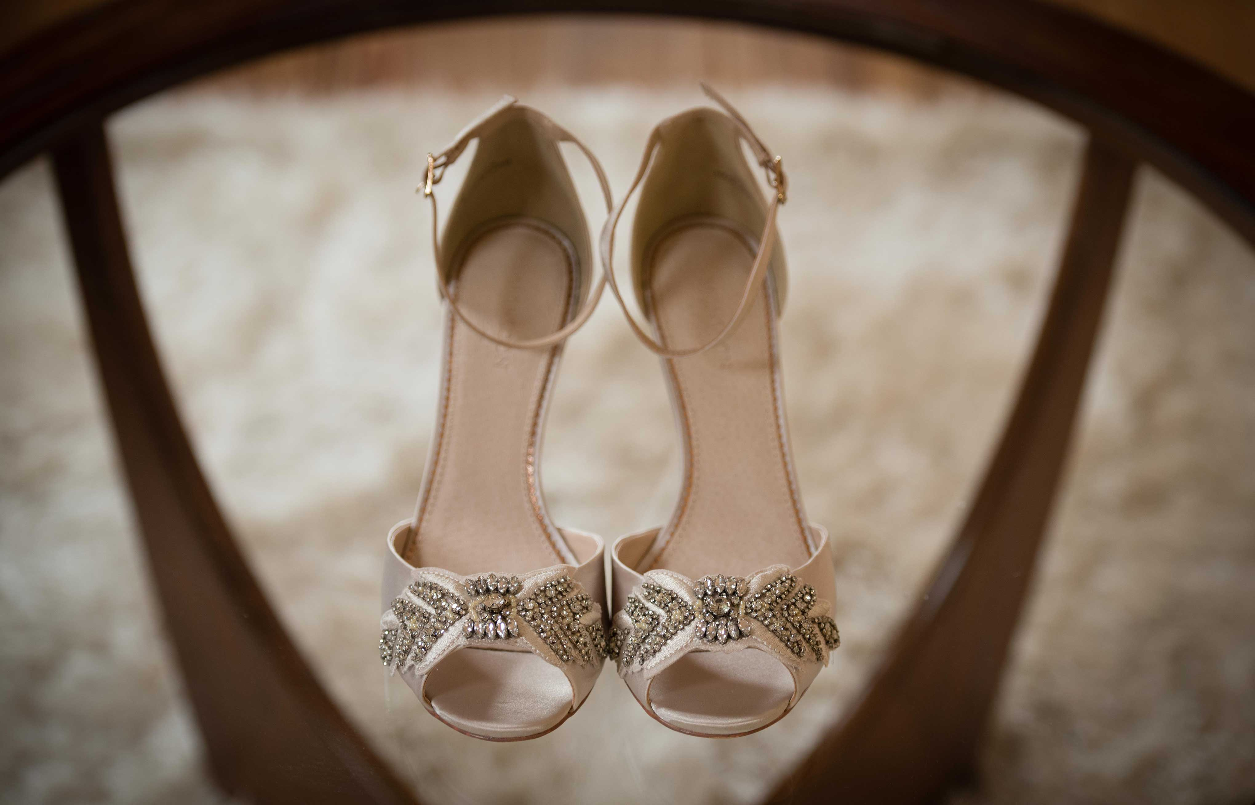 Bride's wedding shoes with bows on front