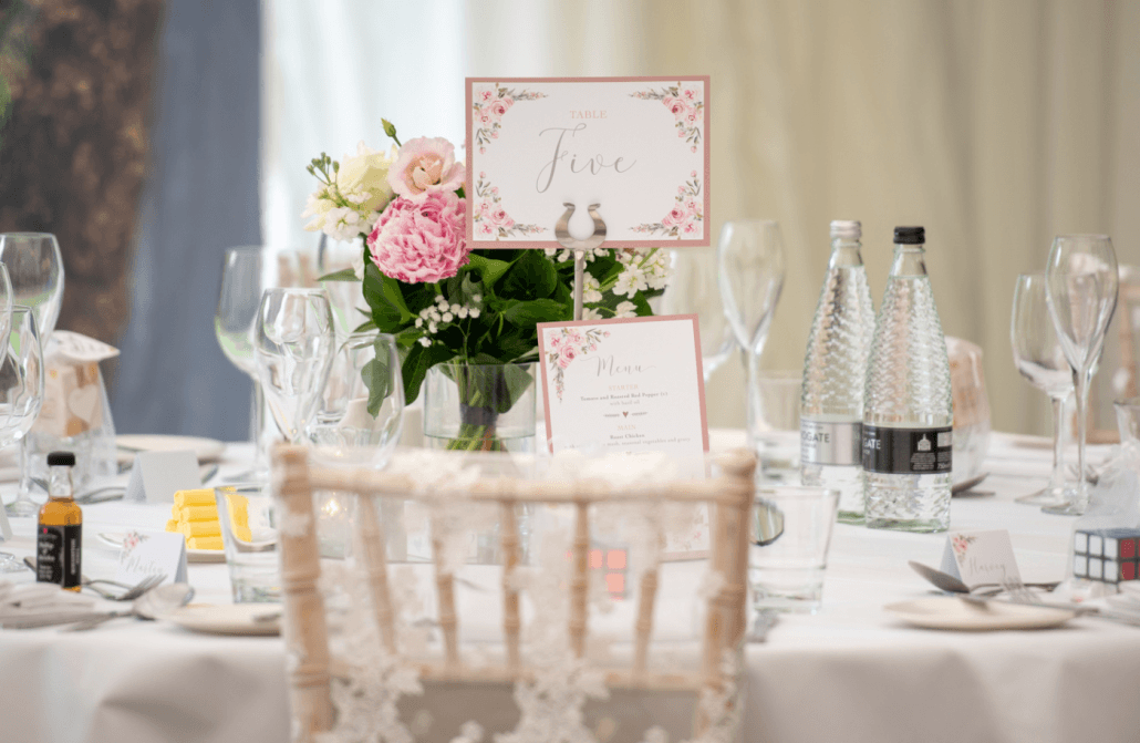 Wedding breakfast - decorated table with bouquet of flowers