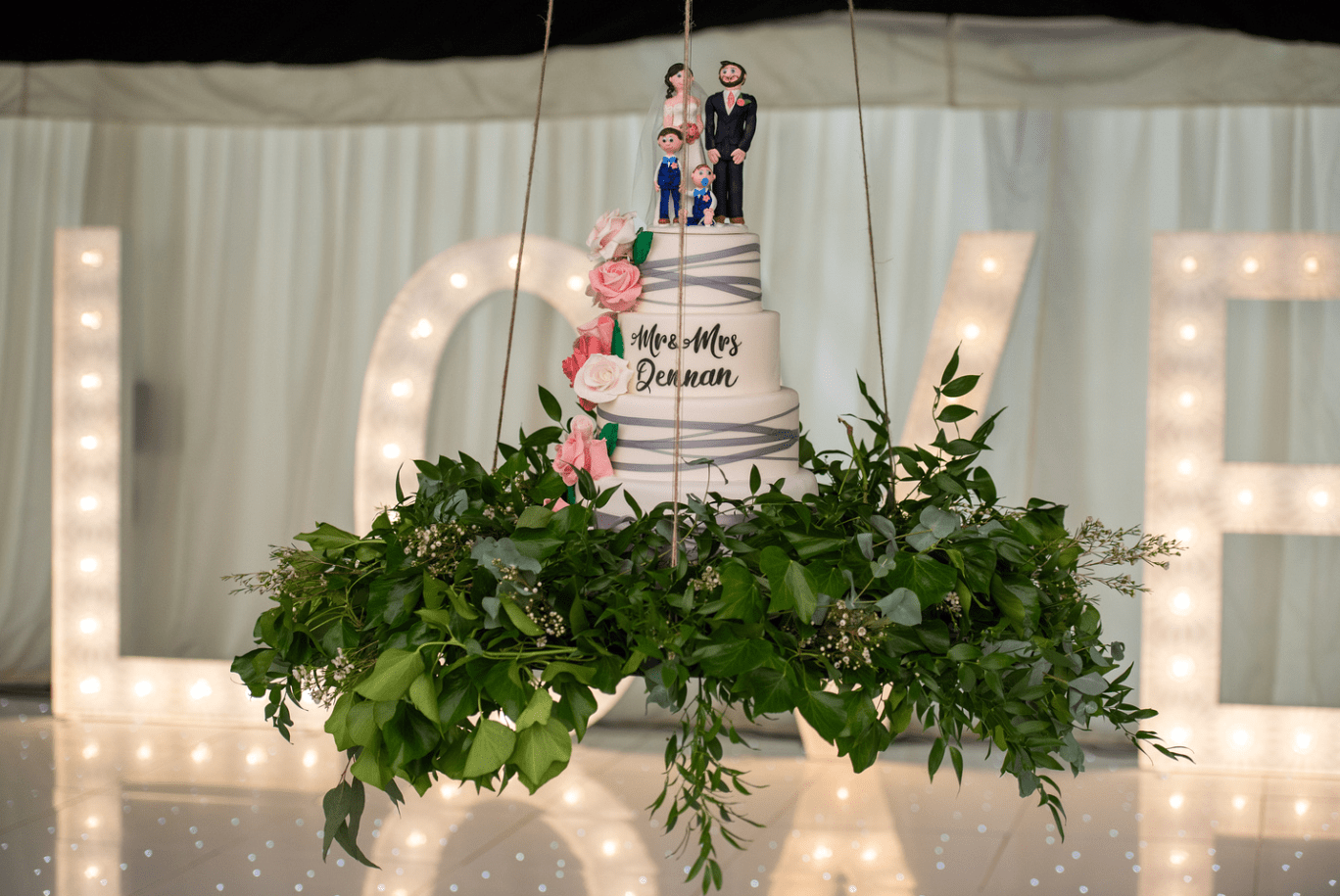 Wedding cake suspended from the ceiling at Soughton Hall
