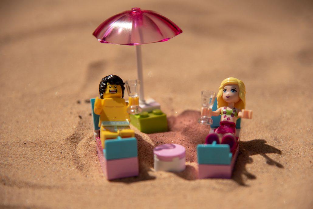 Bride and groom on their honeymoon on the beach