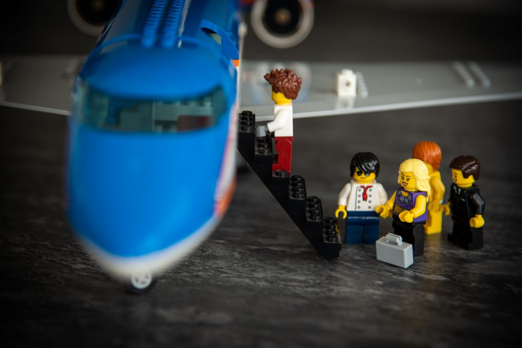 Lego bride and groom boarding the plane