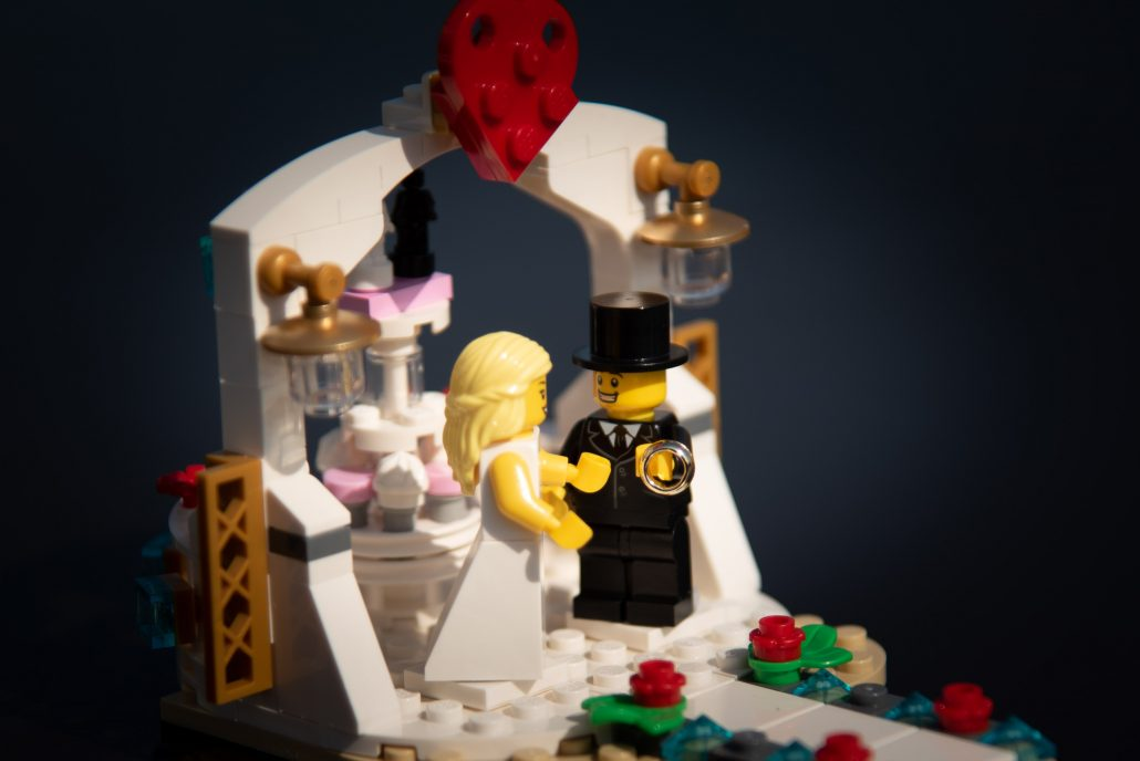 Lego wedding - bride and groom get married in an outdoor ceremony
