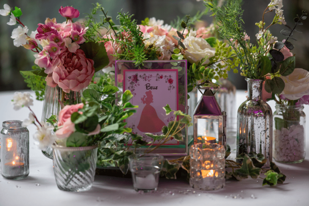 Table plan names surrounded by flowers on each table
