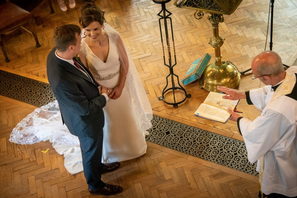 Bride and groom from above getting married in a Shropshire church