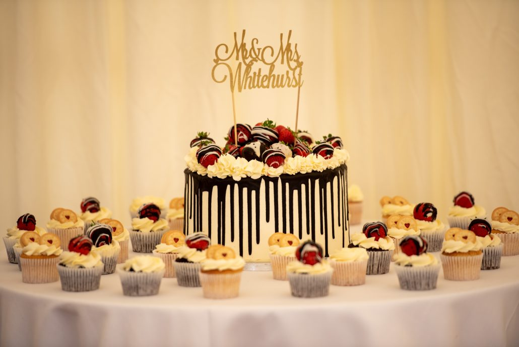 Wedding cake covered in white chocolate and strawberries