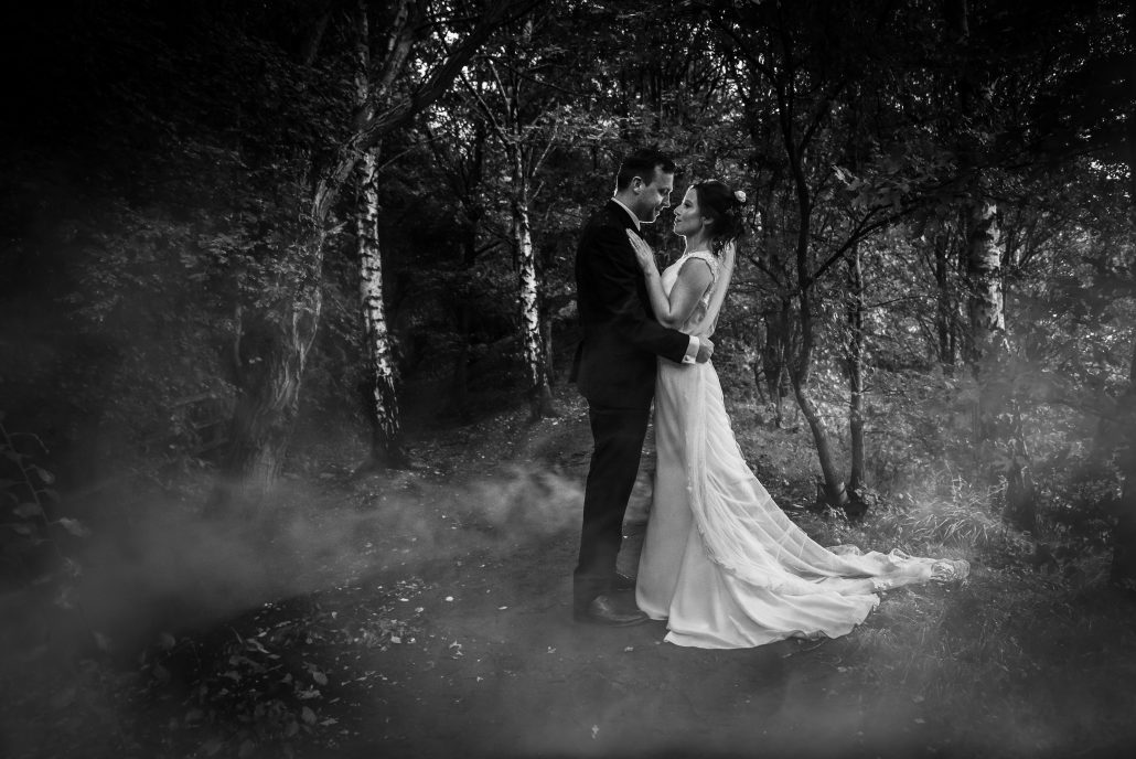Bride and groom by the lake at Alderford