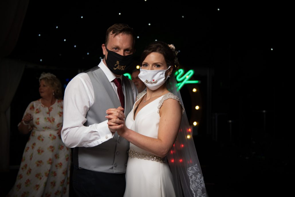 Bride and groom wearing Just Married face masks