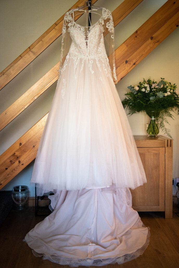 Wedding gown hanging from the staircase