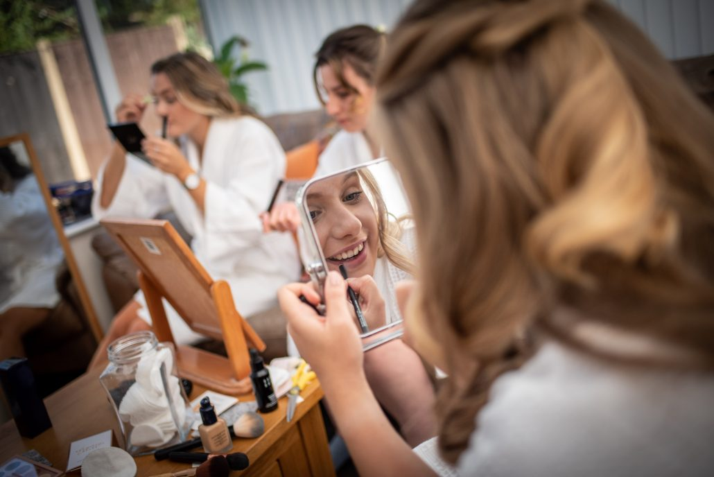 The bridal party doing their own makeup at home