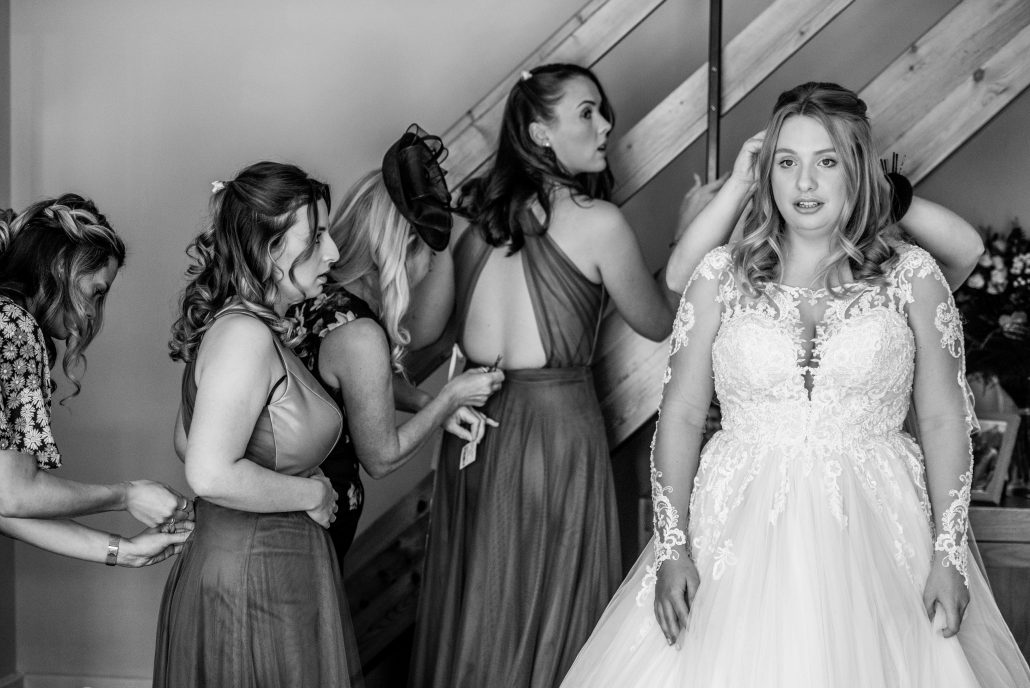Bridal party getting ready and doing their dresses up