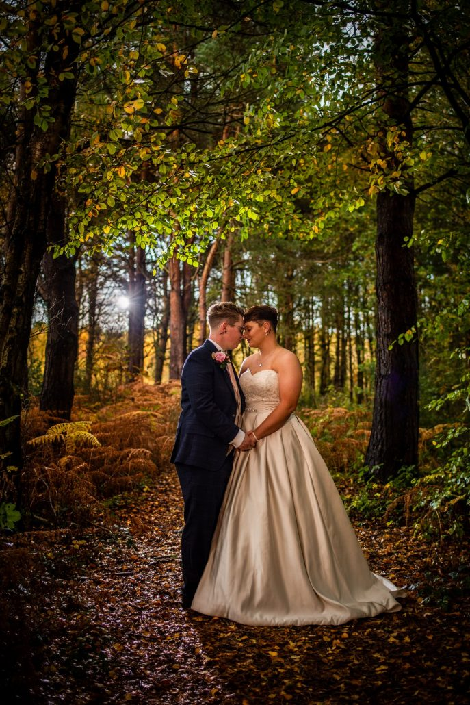 Two brides on their wedding day in the forest