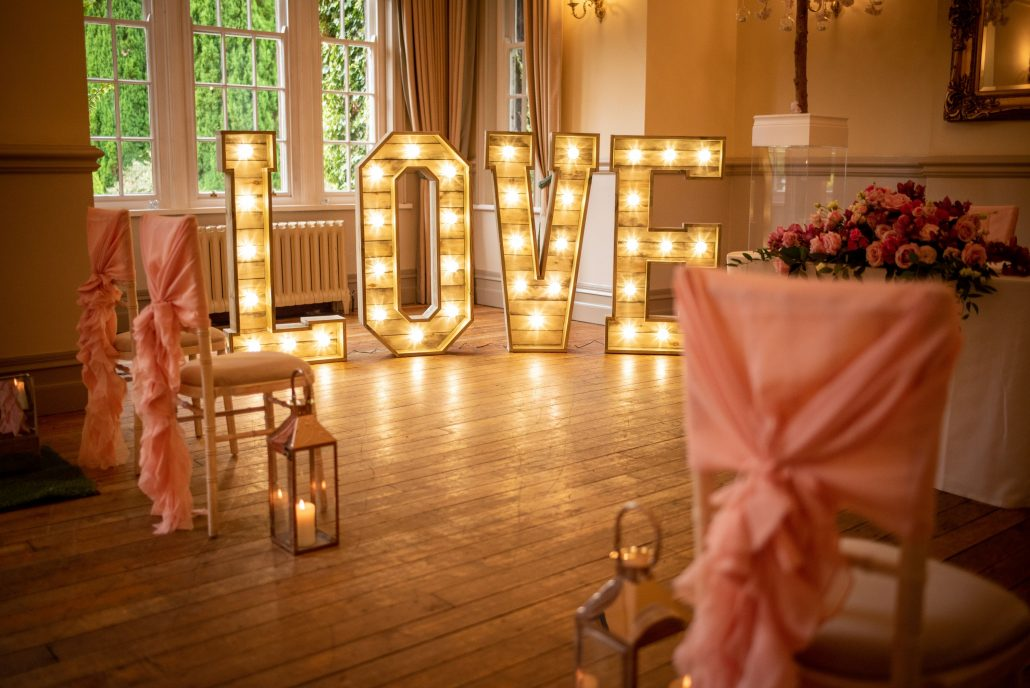 Nunsmere Hall ceremony room with LOVE letters lit up